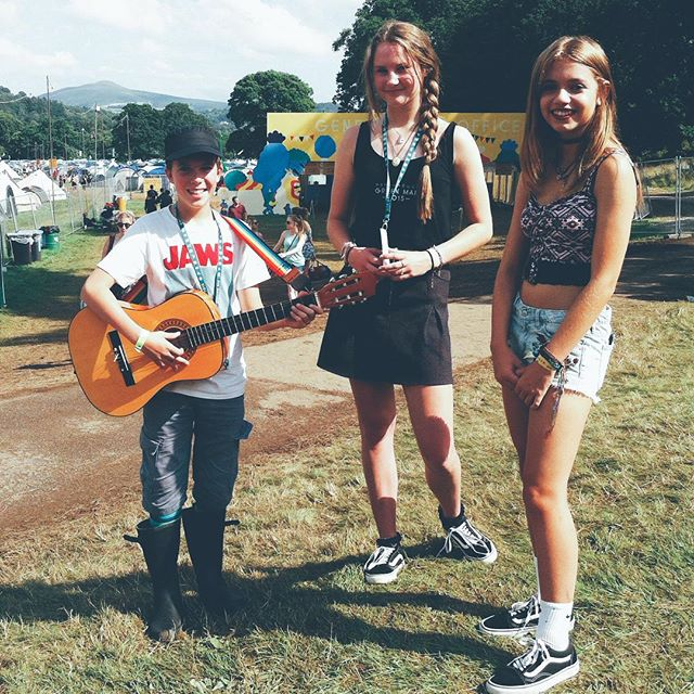 This is Amelia, Charlotte and James and I found them busking at the entrance to @greenmanfest playing @superfurryanimals' Fire In My Heart very beautifully, and for that they deserve some sort of youth enterprise award. #wales #concertphotography #vscocam